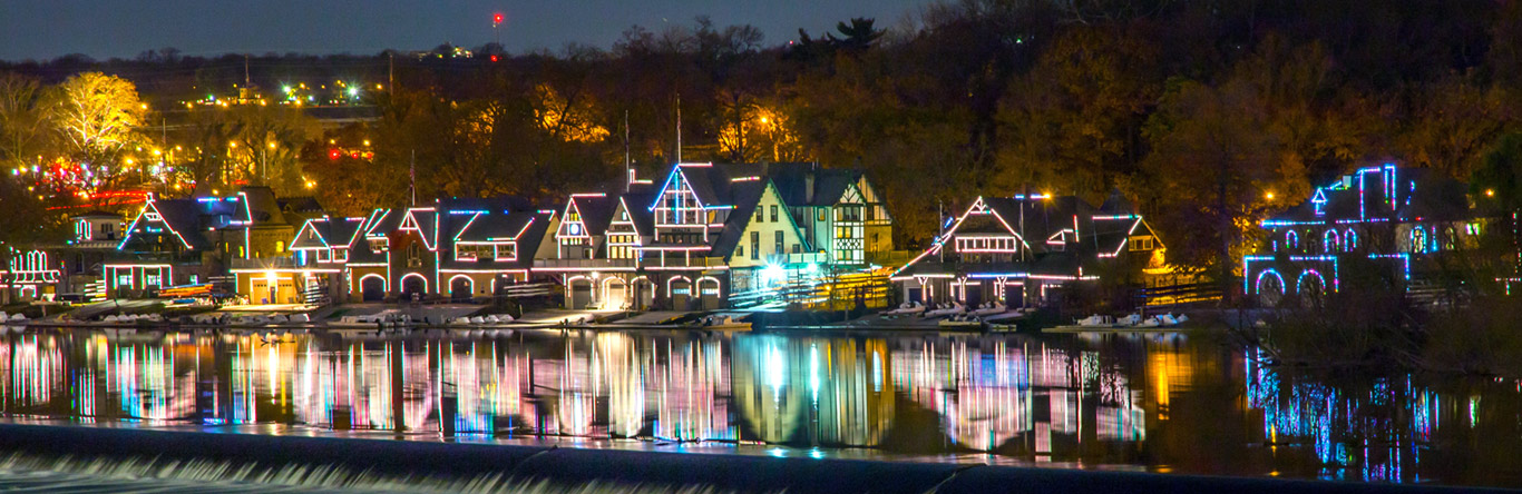 homes with colorful lights along river